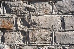 Mur de briques inégal de cru photo stock