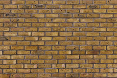 Mur de briques jaune photo stock