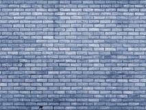 Mur de briques modifié la tonalité bleu répétant le modèle Photo stock