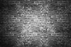 Mur de briques noir pour le fond Photos libres de droits