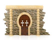 Mur de briques ruiné et porte en bois brune Images libres de droits