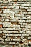 Mur de briques superficiel par les agents Photos libres de droits