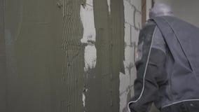 Mur de mastic de mastic de constructeur banque de vidéos