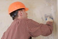 Mur de pierres sèches enregistrant l'entrepreneur sur bande Image stock