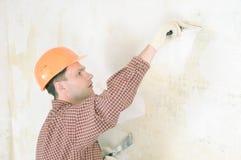 Mur de pierres sèches enregistrant l'entrepreneur sur bande Photographie stock