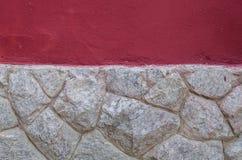 Mur de roche avec le mur rouge de texture Photo libre de droits