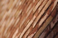 Mur de rouge de brique Photographie stock libre de droits
