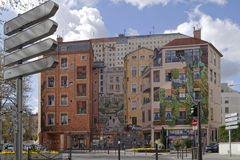 The Mur des Canuts in Croix-Rousse. LYON, FRANCE, April 8, 2016 : Realized in 1987 in Croix-Rousse district, Mur des Canuts is the biggest fresco in Europe Royalty Free Stock Photo