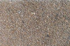 Mur des pierres et du petit sable de la taille différente, fond, série de texture Image stock