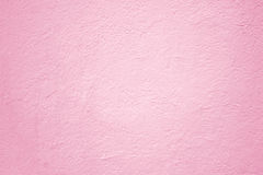 Mur en béton rose, fond extérieur de plâtre de texture pour le desig Image libre de droits