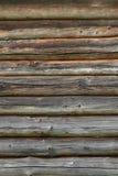 Mur en bois des rondins vieux comme texture de fond Images stock