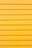 Mur en bois jaune - fond Photo stock