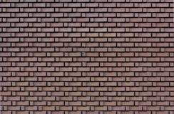 Mur en pierre avec la brique en forme de L Photos stock