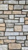Mur en pierre de différentes couleurs et dimensions Illustration Libre de Droits