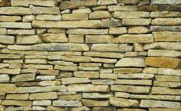 Mur en pierre jaune Images libres de droits