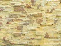 Mur en pierre jaune Images stock