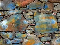 Mur en pierre peint Photographie stock libre de droits