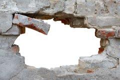 Mur endommagé avec le trou informe photographie stock
