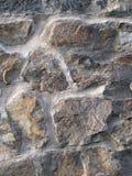 Mur ensoleillé de roche Photographie stock libre de droits