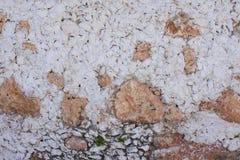 Mur extérieur rustique de pierre et de stuc Photos stock