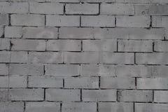 Mur fait d'unités concrètes grises de maçonnerie photographie stock
