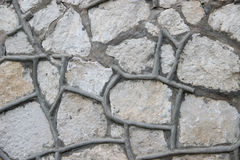 Mur fait de roches naturelles Images stock
