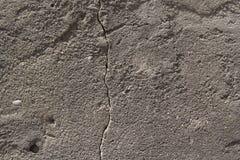 Mur gris de ciment avec une surface rouillée photo libre de droits