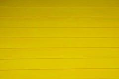 Mur jaune abstrait en bois de texture de fond Photographie stock