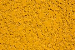 Mur jaune lumineux de stuc Fond Photographie stock libre de droits