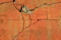 Mur orange criqué Photographie stock libre de droits
