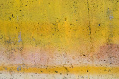 Mur peint jaune grunge Images stock