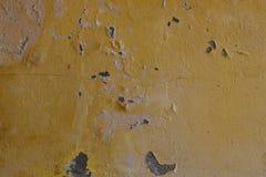 Mur peint par jaune avec des taches Photo libre de droits