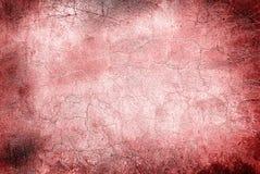 Mur rouge avec des fissures images stock