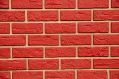 Mur rouge de pseudo-brique Photo libre de droits