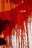 Mur souillé par rouge Photographie stock