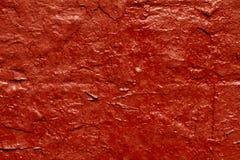Mur texturisé rouge Photos stock