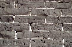 Mur texturisé rugueux dans le noir Photographie stock libre de droits