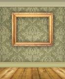Mur vert de damassé avec le cadre de tableau vide photos stock