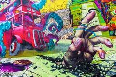 Mural τέχνη σε έναν τοίχο στην πόλη του Λονδίνου, UK Στοκ Εικόνες