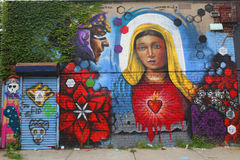 Mural art in Astoria section in Queens. NEW YORK - JULY 24, 2014 Mural art in Astoria section in Queens. A mural is any piece of artwork painted or applied Royalty Free Stock Images