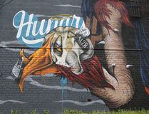 Mural art in Astoria section in Queens. NEW YORK - JULY 24, 2014 Mural art in Astoria section in Queens. A mural is any piece of artwork painted or applied Stock Image