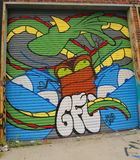 Mural art in Astoria section of Queens. NEW YORK - JULY 24, 2014: Mural art in Astoria section of Queens. A mural is any piece of artwork painted or applied Stock Photography