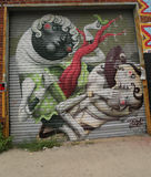 Mural art in Astoria section of Queens. NEW YORK - JULY 24, 2014: Mural art in Astoria section of Queens. A mural is any piece of artwork painted or applied Stock Images