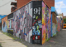 Mural art in Astoria section of Queens. NEW YORK - JULY 24, 2014: Mural art in Astoria section of Queens. A mural is any piece of artwork painted or applied Royalty Free Stock Photography