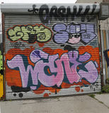 Mural art in Astoria section of Queens. NEW YORK - JULY 24, 2014: Mural art in Astoria section of Queens. A mural is any piece of artwork painted or applied Royalty Free Stock Images