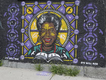 Mural art in Astoria section of Queens. NEW YORK - JULY 24, 2014: Mural art in Astoria section of Queens. A mural is any piece of artwork painted or applied Royalty Free Stock Image
