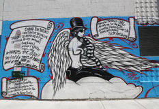 Mural art in Astoria section of Queens. NEW YORK - JULY 24, 2014: Mural art in Astoria section of Queens. A mural is any piece of artwork painted or applied Stock Photos