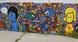 Mural art in Astoria section of Queens. NEW YORK - JULY 24, 2014: Mural art in Astoria section of Queens. A mural is any piece of artwork painted or applied Royalty Free Stock Photo