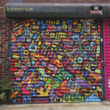 Mural art in Astoria section of Queens. NEW YORK - JULY 24, 2014: Mural art in Astoria section of Queens. A mural is any piece of artwork painted or applied Stock Photo