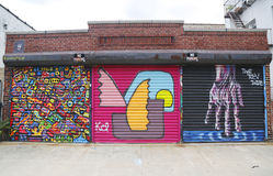 Mural art in Astoria section of Queens. NEW YORK - JULY 24, 2014: Mural art in Astoria section of Queens. A mural is any piece of artwork painted or applied Royalty Free Stock Photos